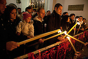 Families light their devotional candles at the sanctuary of Sant Alfio during the festival of Sant' Alfio at Trecastagni, Sicily, Italy.