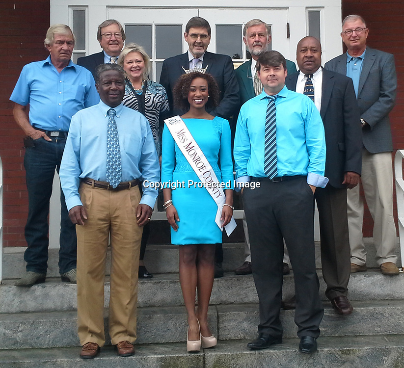 RAY VAN DUSEN/BUY AT PHOTOS.MONROECOUNTYJOURNAL.COM<br /> Miss Monroe County Alivia Roberts, front center, appeared before the board of supervisors Monday. The incoming Mississippi State University senior will sign copies of her first book, &quot;Leaping into Your Destination,&quot; June 8 at Amory Regional Museum from 5 until 7 p.m.