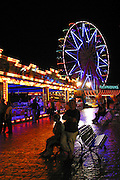 The Big Wheel and other attractions at an amusement park in Maspalomas beach, Gran Canaria, Canary Islands, Spain.