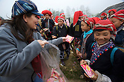 Hilltribe villages around Sapa. Vietnamese businesswoman distributing goods to Red Dzao women.