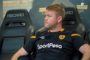Hull City Head Coach Grant McCann sat in the dug out prior to kick off during the EFL Sky Bet Championship match between Hull City and Bristol City at the KCOM Stadium, Kingston upon Hull, England on 24 August 2019.