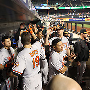 Chris Davis, Baltimore Orioles, celebrates a home run with his team mates in the dugout during the New York Mets Vs Baltimore Orioles MLB regular season baseball game at Citi Field, Queens, New York. USA. 5th May 2015. Photo Tim Clayton