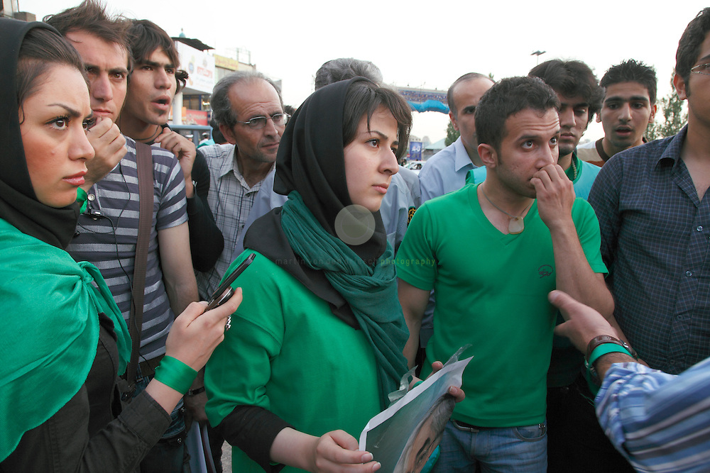 Confrontation course: Mousavi activists in a heated debate with supporters of the incumbent president Mahmoud Ahmadinejad.