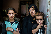 9 August 2018 – Mosul – Iraq – An Iraqi woman and her children are photographed inside their home in the Wadi Hadjar neighbourhood of West Mosul. <br /> <br /> This home is amongst the houses due to be rehabilitated in West Mosul with the support of UNDP's Funding Facility for Stabilization (FFS). <br /> <br /> © UNDP Iraq / Claire Thomas