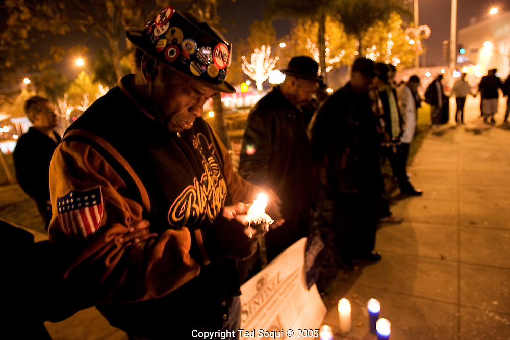 "Los Angeles residents gather and pray as Stanley ""Tookie"" Williams is executed in San Quinten's death chamber around midnight. People have gathered throughout the day at Leimert Park in South Central LA to remember ""Tookie""."