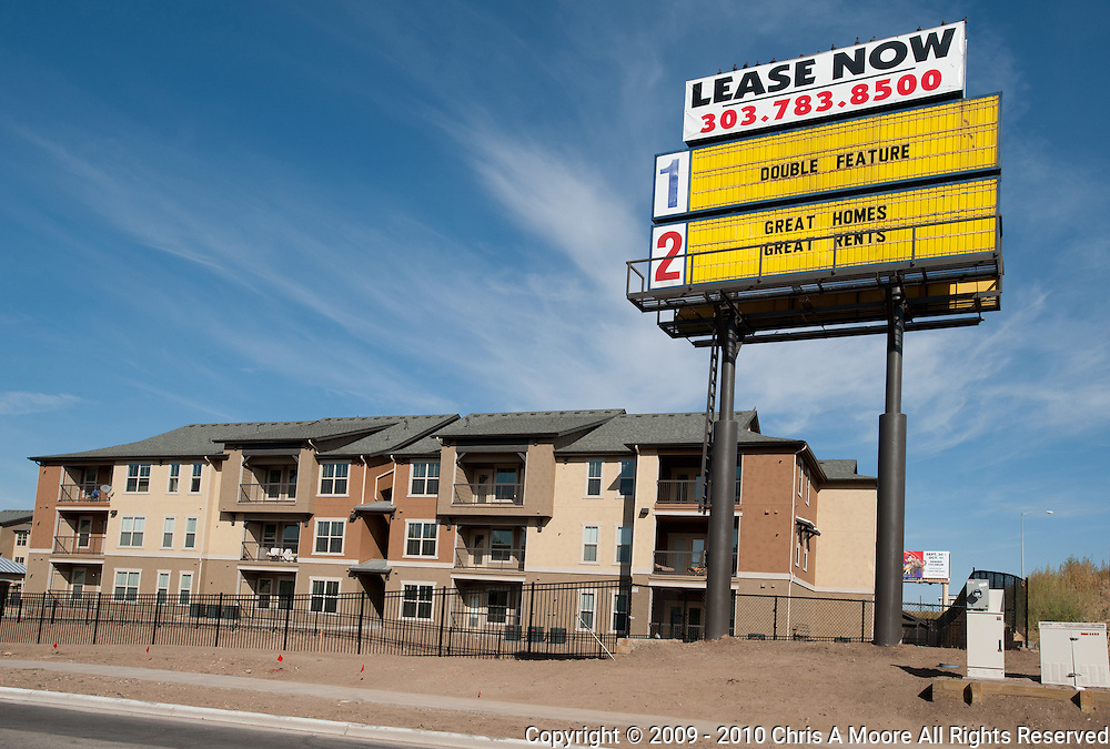 "The Cinderella Twin Sign has been covered with ""Lease Now"" and uses the Double Feature for Great Homes and Great Rents."