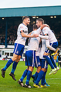 Danny Mayor of Bury (right) is mobbed by team mates after scoring his sides second goal during the FA Cup match at Gigg Lane, Bury<br /> Picture by Matt Wilkinson/Focus Images Ltd 07814 960751<br /> 07/11/2015