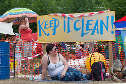 © licensed to London News Pictures. London, UK 04/08/2013. People protest against oil exploration in Balcombe, West Sussex on Sunday, August 04, 2013, after energy company Cuadrilla began drilling at the site two days ago. Photo credit: Tolga Akmen/LNP