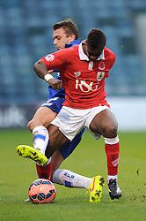 Bristol City's Kieran Agard is challenged by Gillingham's Doug Loft - Photo mandatory by-line: Dougie Allward/JMP - Mobile: 07966 386802 - 08/11/2014 - SPORT - Football - Gillingham - Priestfield Stadium - Gillingham v Bristol City - FA Cup - Round One