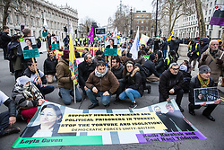 London, UK. 19th January, 2019. Members of the Kurdish community stage a sitdown protest outside Downing Street in support of jailed Kurdish politician Leyla Güven and her fellow hunger striking prisoners Esat Naci Yıldırım and Kadir Karabak.