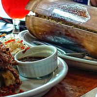 Entree & Sides: Crispy pork pata with rice in a Bamboo log