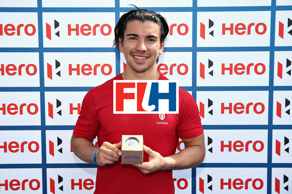 LONDON, ENGLAND - JUNE 17: Gabriel Ho-Garcia of Canada receives an award to commemorate his 100th cap during the Hero Hockey World League Semi Final match between Canada and India at Lee Valley Hockey and Tennis Centre on June 17, 2017 in London, England.  (Photo by Alex Morton/Getty Images)