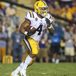 Sep 29, 2018; Baton Rouge, LA, USA; LSU Tigers running back Nick Brossette (4) against the Mississippi Rebels during the second quarter of a game at Tiger Stadium. Mandatory Credit: Derick E. Hingle-USA TODAY Sports