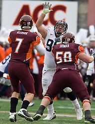 Virginia NT Nick Jenkins (96) put pressure on Virginia Tech quarterback Sean Glennon (7).  The Virginia Tech Hokies defeated the Virginia Cavaliers 17-14 in NCAA football at Lane Stadium on the campus of Virginia Tech in Blacksburg, VA on November 29, 2008.