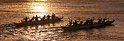 Sunset outrigger canoe paddlers, Hawaii