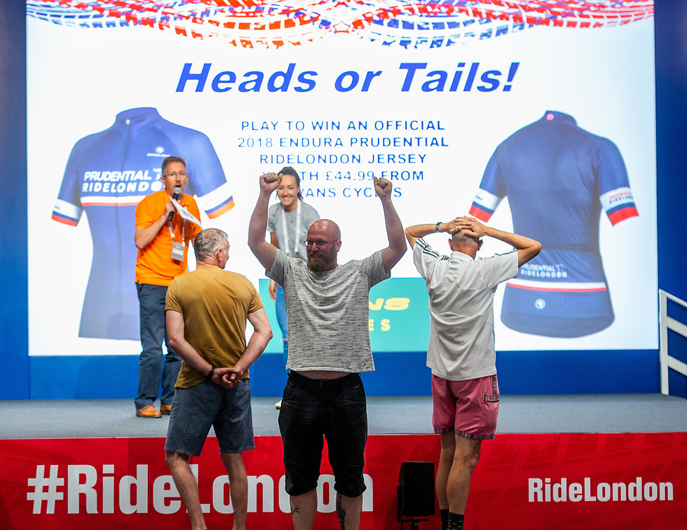 A visitor celebrates during a game at the Main Stage. The Cycling Show at Excel London. 26th July 2018<br /> <br /> Photo: Anthony Upton for Prudential RideLondon<br /> <br /> Prudential RideLondon is the world's greatest festival of cycling, involving 100,000+ cyclists - from Olympic champions to a free family fun ride - riding in events over closed roads in London and Surrey over the weekend of 28th and 29th July 2018<br /> <br /> See www.PrudentialRideLondon.co.uk for more.<br /> <br /> For further information: media@londonmarathonevents.co.uk