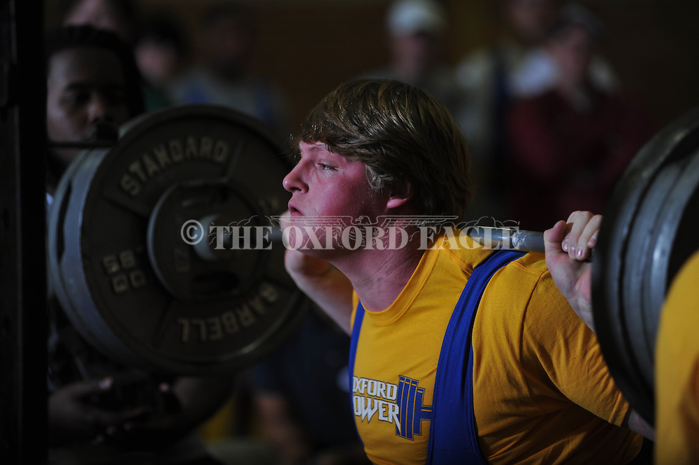 Joel Forrester squats during Class 5A Region weightlifting competition at Oxford High School in Oxford, Miss. on Saturday, February 9, 2013.