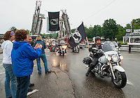 A steady line of motorcyclists arrive at Hesky Park in Meredith during the Freedom Ride gathering Thursday evening.  (Karen Bobotas/for the Laconia Daily Sun)