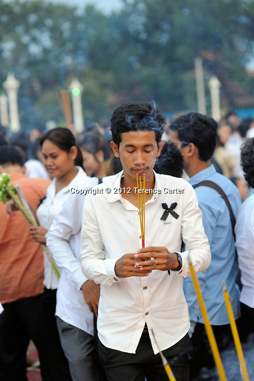 A mourner pays his respects after King Father Norodom Sihanouk's body is returned to the Royal Palace, Phnom Penh, starting a week of mourning in Cambodia.
