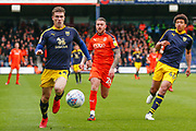 Oxford United midfielder Josh Ruffels (14) attacks, Luton Town midfielder George Moncur (20), Oxford United defender Nico Jones (46), during the EFL Sky Bet League 1 match between Luton Town and Oxford United at Kenilworth Road, Luton, England on 4 May 2019.