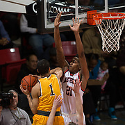 31 January 2017:  The San Diego State Aztecs men's basketball team hosts Wyoming Tuesday night at Viejas Arena.  San Diego State forward Malik Pope (21) defending the hoop against Wyoming guard Justin Jame (1) in the first half. The Aztecs lead the Cowboys 31-27 at half time. www.sdsuaztecphotos.com