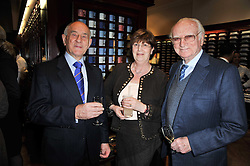 Left to right, BOB & PAM SUTTON who own the Arkle Bookshop at Cheltenham and SIR PETER O'SULLEVAN at a party to celebrate the paperback publication of Lucky Break by leading trainer Paul Nicholls held at Thomas Pink, 85 Jermyn Street, London on 23rd February 2011.