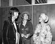 """Arrivals of Eric Clapton and Judy Geeson at DAP..1975..13.09.1975..09.13.1975..13th September 1975..Today saw the arrivals of musician Eric Clapton and actress Judy Geeson at Dublin Airport. They are in Ireland to take part in """"Circasia 75"""" at Straffan House,Co Kildare..Image shows Eric Clapton and Patti Harrison and Judy Geeson meeting up in the VIP lounge at Dublin Airport."""