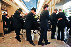 20 November 2015. Orpheum Theater, New Orleans, Louisiana. <br /> Memorial service for musician Allen Toussaint. <br /> Pall bearers remove Toussaint's casket from the theater..<br /> Photo; Charlie Varley/varleypix.com