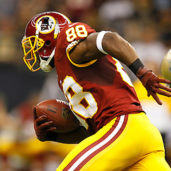 September 9, 2012; New Orleans, LA, USA; Washington Redskins wide receiver Pierre Garcon (88) runs after a catch for a touchdown against the New Orleans Saints during the first quarter of a game at the Mercedes-Benz Superdome. Mandatory Credit: Derick E. Hingle-US PRESSWIRE