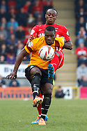 Moses Odubajo of Leyton Orient (rear) challenges Aaron McLean of Bradford City (front) during the Sky Bet League 1 match at the Matchroom Stadium, London<br /> Picture by David Horn/Focus Images Ltd +44 7545 970036<br /> 29/03/2014