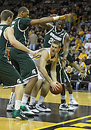 February 2 2011: Iowa Hawkeyes guard Matt Gatens (5) looks to pass while being defended by three players during the first half of an NCAA college basketball game at Carver-Hawkeye Arena in Iowa City, Iowa on February 2, 2011. Iowa defeated Michigan State 72-52.