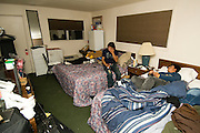 NEWS&GUIDE PHOTO / PRICE CHAMBERS.After a long day at work, the Corona brothers sink into the beds of their small motel room in Jackson as spanish television programming washes over a conversation about when they might leave.