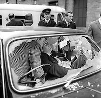 "RUC Constable Eric Aiken lies injured in the passenger seat of a patrol car which came under gun attack by the Provisional IRA when it halted at traffic lights at Durham Street-Divis Street. The driver was able to make it back to Springfield Road police station where an ambulance has just arrived. Later police released a statement which said that Constable Aiken was ""comfortable"". The incident happened August 1971. 19710800083<br />