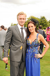 NATALIE PINKHAM and OWAIN WALBYOFF at the third day of the 2010 Glorious Goodwood racing festival at Goodwood Racecourse, Chichester, West Sussex on 29th July 2010.