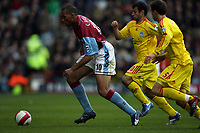 Photo: Rich Eaton.<br /> <br /> Aston Villa v Liverpool. The Barclays Premiership. 18/03/2007. John Carew left of Villa evades Javier Mascherano #20 and Daniel Agger #5
