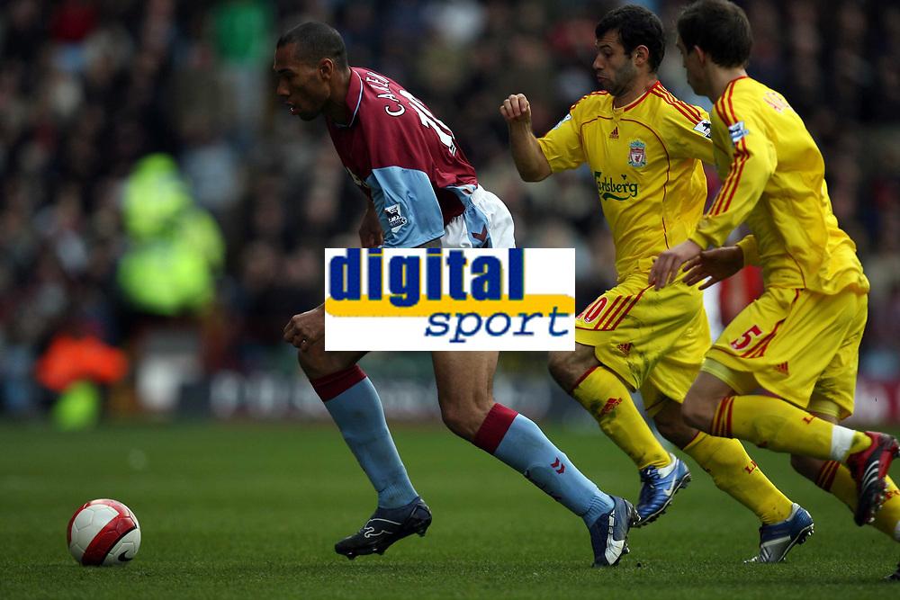 Photo: Rich Eaton.<br /> <br /> Aston Villa v Liverpool. The Barclays Premiership. 18/03/2007. John Carew left of Villa evades Javier Mascherano #20 and Daniel Agger #5