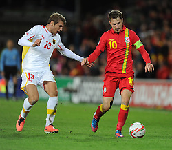 Aaron Ramsey of Wales runs down the line with pressure from Stefan Ristovski of Macedonia - Photo mandatory by-line: Alex James/JMP - Tel: Mobile: 07966 386802 11/10/2013 - SPORT - FOOTBALL - INTERNATIONAL - Cardiff - Wales V Macedonia - WORLD CUP 2014 QUALIFYING - GROUP A