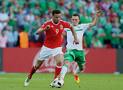 PARIS, FRANCE - Saturday, June 25, 2016: Wales' Hal Robson-Kanu in action against Northern Ireland's Corry Evans during the Round of 16 UEFA Euro 2016 Championship match at the Parc des Princes. (Pic by David Rawcliffe/Propaganda)