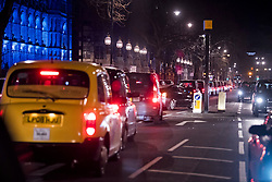 © Licensed to London News Pictures. 07/02/2018. London, UK.  Taxis block the road outside the venue as  a protest against the conservatives as guests leave the Natural History Museum in London following the annual Black and White Ball, a fundraiser held by the Conservative Party. Photo credit: Ben Cawthra/LNP