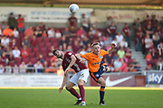 Northampton Town midfielder Jack Bridge (36) heads the ball under pressure from Oldham Athletic defender (on loan from Manchester City) Kean Bryan (34) during the EFL Sky Bet League 1 match between Northampton Town and Oldham Athletic at Sixfields Stadium, Northampton, England on 5 May 2018. Picture by Dennis Goodwin.