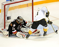 Matt Calvert of the Brandon Wheat Kings tries to put the puck by Calgary Hitmen goalie Martin Jones in Game 6 of the 2010 MasterCard Memorial Cup in Brandon, MB on Wednesday May 19, 2010. Photo by Aaron Bell/CHL Images