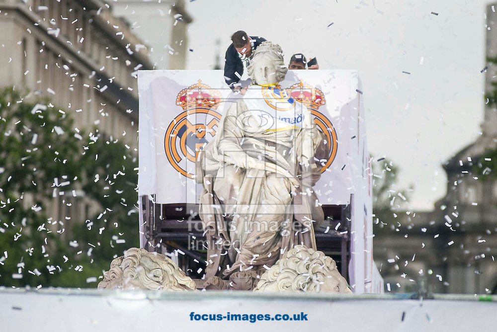 Real Madrid players celebrate winning the UEFA Champions League with an open top bus tour at Cibeles Square, Madrid<br /> Picture by EXPA Pictures/Focus Images Ltd 07814482222<br /> 29/05/2016<br /> ***UK &amp; IRELAND ONLY***<br /> EXPA-ESP-160529-0121.jpg