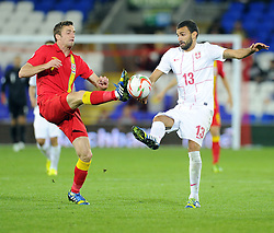 Andy King of Wales (Leicester City) battles for the ball with Ivan Radovanovic of Serbia (Chievo)  - Photo mandatory by-line: Joe Meredith/JMP - Tel: Mobile: 07966 386802 10/09/2013 - SPORT - FOOTBALL - Cardiff City Stadium - Cardiff -  Wales V Serbia- World Cup Qualifier