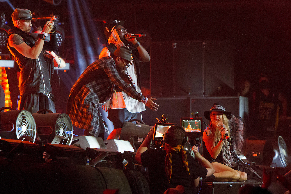 Fergie and the Black Eyed Peas make a special guest appearance during the David Guetta set the Coachella Music Festival on Sunday, April 12, 2015.