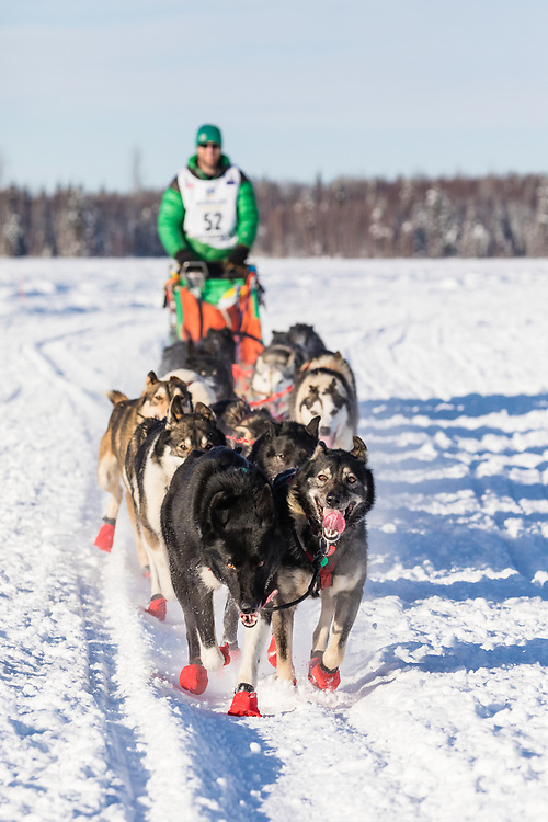 Musher Kelly Maixner after the restart in Willow of the 46th Iditarod Trail Sled Dog Race in Southcentral Alaska.  Afternoon. Winter.