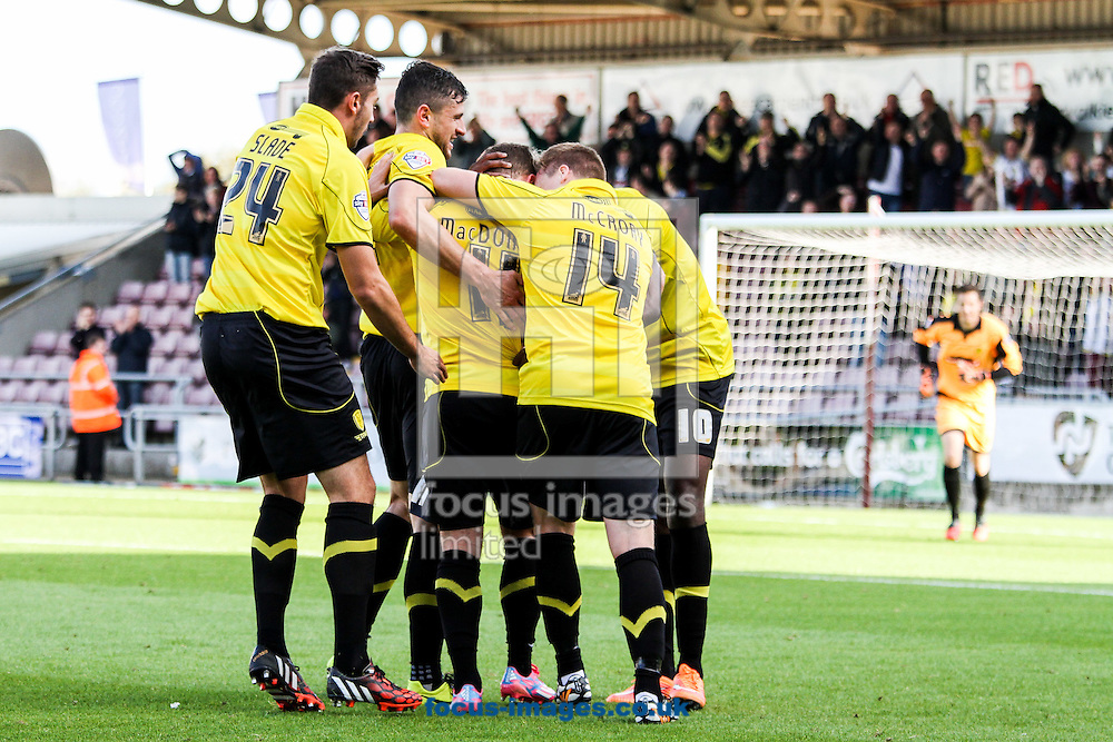 Burton players celebrate after a goal from Alex MacDonald of Burton Albion (centre) during the Sky Bet League 2 match at Sixfields Stadium, Northampton<br /> Picture by Andy Kearns/Focus Images Ltd 0781 864 4264<br /> 11/10/2014