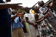 Mentally disabled children sing in front of other members of the Harmony Community Centre at the Buduburam refugee settlement, roughly 20 km west of Ghana's capital Accra on Friday April 13, 2007. The Buduburam refugee settlement is still home over 30,000 Liberians, most of which have mixed feelings about returning to Liberia. The Harmony Community Centre is aimed at helping people with mental and physical disabilities integrate with the community through art, music and theater performances..