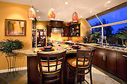 Model Home Kitchen With Slate Tile Flooring And Expresso Cabinets