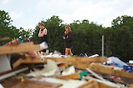 June 06, 2010:  CASSEY MILLER and JJ ADKINS walks on the floor of the home ownned by her parents Tim and Debbie Miller after a tornado hits Ottawa County, OhioTornado destruction in Ottawa County, Ohio
