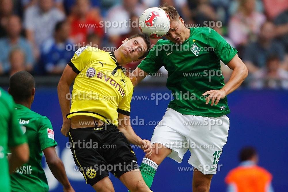 Football - soccer: LIGA total! Cup 2012, Borussia Dortmund - SV Werder Bremen,  .Robert Lewandowski (Borussia Dortmund, #9), Sebastian Proedl (SV Werder Bremen, #15) *** Local Caption *** © pixathlon